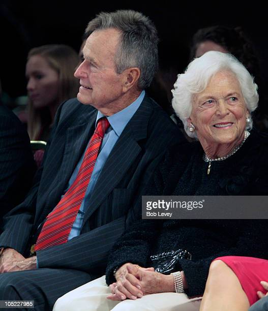 Former President George HW Bush along with wife Barbara Bush sit on the front row as they await for their granddaughter designer Lauren Bush to show...