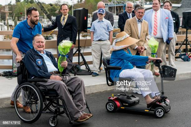Former President George HW Bush and first lady Barbara Bush leave the Mathew J Lanigan bridge that connects Kennebunk and Kennebunkport after its...