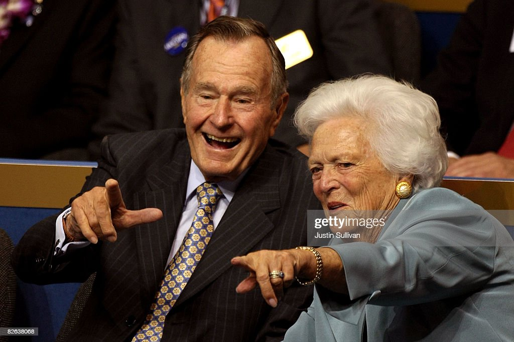 Former President George HW Bush and former first lady Barbara Bush point from their seats on day two of the Republican National Convention at the...