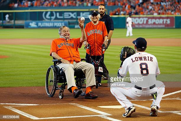 Former President George HW Bush throws out the ceremonial first pitch to Jed Lowrie of the Houston Astros as former First Lady Barbara Bush looks on...