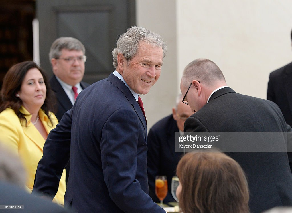 Former President George W. Bush and Alan Lowe, director of the George W. Bush Presidential Center arrive for a signing ceremony for the joint use agreement between the National Archive and the George W. Bush Presidential Center on the campus of Southern Methodist University on April 24, 2013 in Dallas, Texas. Dedication of the George W. Bush Presidential Library is to take place on April 25 with all five living U.S. Presidents in attendance.