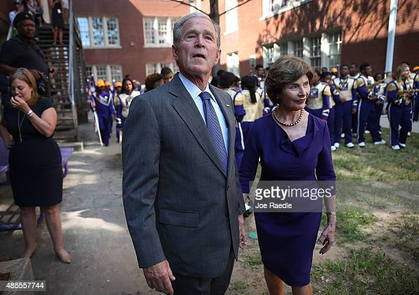 Former President George W Bush and former First Lady Laura Bush visit the Warren Easton High School during an event to mark the 10th anniversary of...