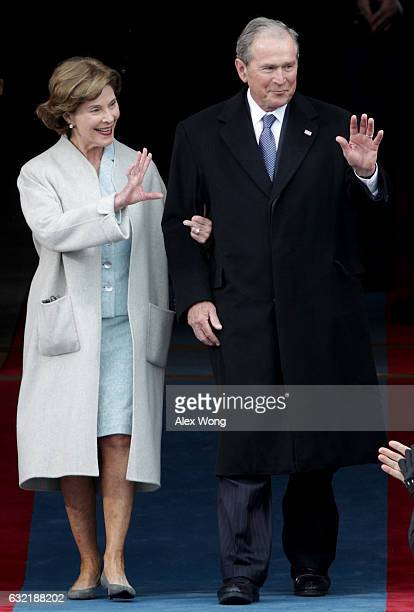 Former President George W Bush and Laura Bush wave as they arrive on the West Front of the US Capitol on January 20 2017 in Washington DC In today's...