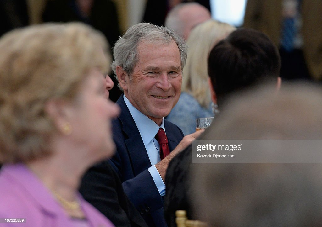 Former President George W. Bush attends a signing ceremony inside the Freedom Hall for the joint use agreement between the National Archive and the George W. Bush Presidential Center on the campus of Southern Methodist University on April 24, 2013 in Dallas, Texas. Dedication of the George W. Bush Presidential Library is to take place on April 25 with all five living U.S. Presidents in attendance.