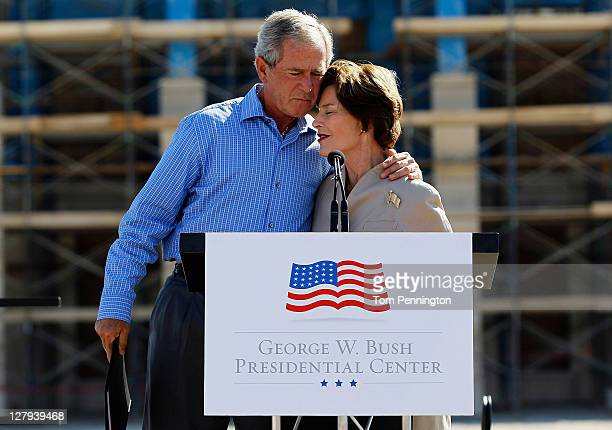 Former President George W Bush hugs his wife Laura Bush during the George W Bush Presidential Center Topping Out Ceremony on October 3 2011 in Dallas...