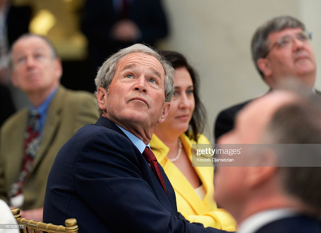 Former President George W. Bush looks at the 360-degree LED high definition video wall inside the Freedom Hall as he participates in a signing ceremony for the joint use agreement between the National Archive and the George W. Bush Presidential Center on the campus of Southern Methodist University on April 24, 2013 in Dallas, Texas. Dedication of the George W. Bush Presidential Library is to take place on April 25 with all five living U.S. Presidents in attendance.