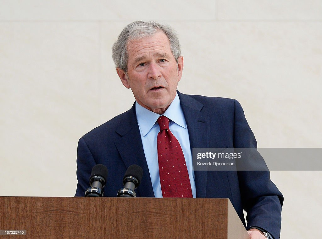 Former President George W Bush participates in a signing ceremony inside the Freedom Hall for the joint use agreement between the National Archive...