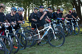 Former President George W Bush speaks to a pack of bicycle riders at his Prairie Chapel Ranch outside Crawford Texas in the fourth annual Wounded...