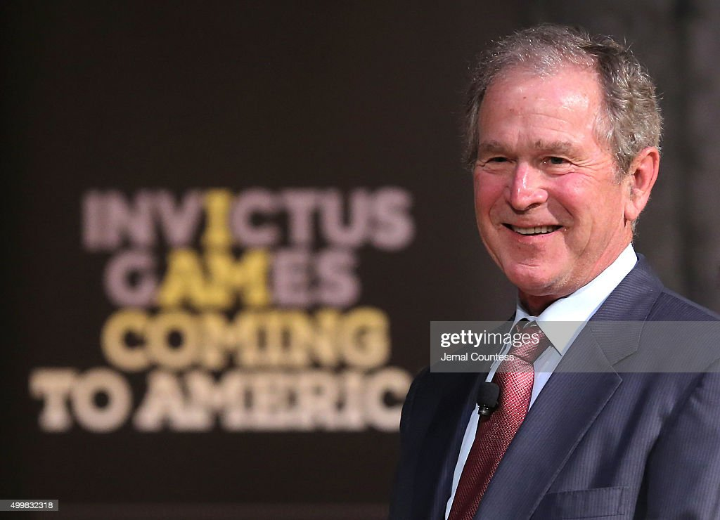 Former President George W. Bush speaks to aspiring Invictus competitors during an event to announce a major initiative prior to the 2016 Invictus Games in Orlando, Florida at the Intrepid Sea-Air-Space Museum on December 3, 2015 in New York City. The announcement was to promote the initiative by the George W. Bush Institute in partnership with the Invictus Games to address the invisible wounds of war and a the role of sports in recovery.