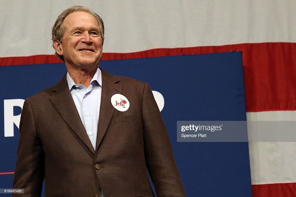 Former President George W Bush stands on stage before speaking in support of his brother Republican presidential candidate Jeb Bushat a campaign...