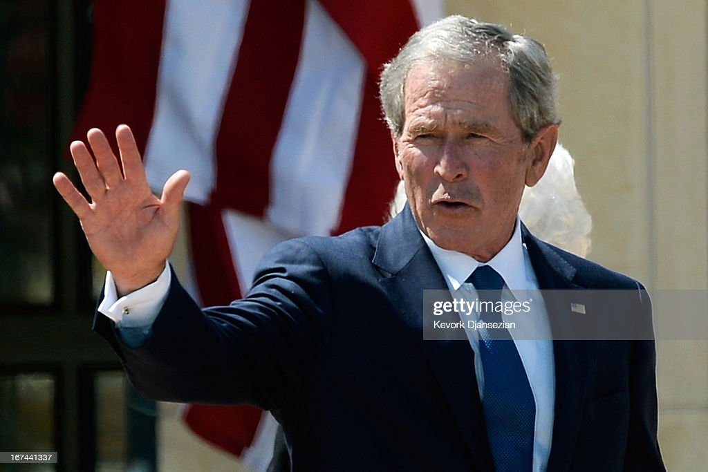Former President <a gi-track='captionPersonalityLinkClicked' href=/galleries/search?phrase=George+W.+Bush&family=editorial&specificpeople=122011 ng-click='$event.stopPropagation()'>George W. Bush</a> waves goodbye after attending the opening ceremony of the <a gi-track='captionPersonalityLinkClicked' href=/galleries/search?phrase=George+W.+Bush&family=editorial&specificpeople=122011 ng-click='$event.stopPropagation()'>George W. Bush</a> Presidential Center April 25, 2013 in Dallas, Texas. The Bush library, which is located on the campus of Southern Methodist University, with more than 70 million pages of paper records, 43,000 artifacts, 200 million emails and four million digital photographs, will be opened to the public on May 1, 2013. The library is the 13th presidential library in the National Archives and Records Administration system.