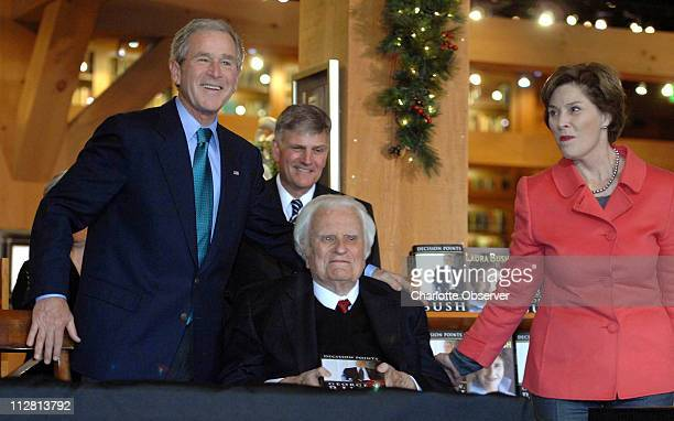 Former President George W Bush with former first lady Laura Bush and Franklin Graham gather around Billy Graham center at the Billy Graham Library...