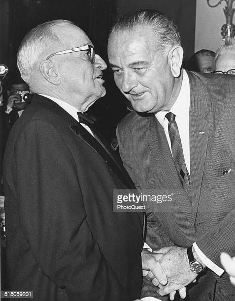Former President Harry S Truman and President Lyndon B Johnson are shown in a close huddle during a party honoring Truman's 80th birthday Washington...