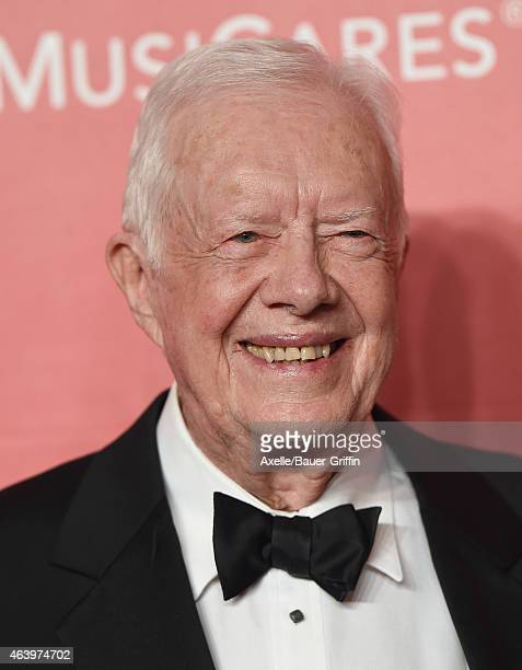 Former President Jimmy Carter arrives at the 2015 MusiCares Person of The Year honoring Bob Dylan at Los Angeles Convention Center on February 6 2015...