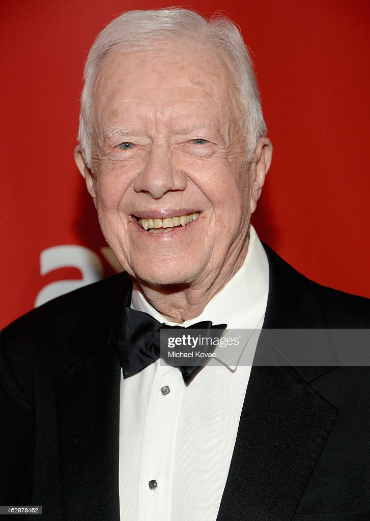 Former President <a gi-track='captionPersonalityLinkClicked' href=/galleries/search?phrase=Jimmy+Carter+-+US+President&family=editorial&specificpeople=93589 ng-click='$event.stopPropagation()'>Jimmy Carter</a> attends the 25th anniversary MusiCares 2015 Person Of The Year Gala honoring Bob Dylan at the Los Angeles Convention Center on February 6, 2015 in Los Angeles, California. The annual benefit raises critical funds for MusiCares' Emergency Financial Assistance and Addiction Recovery programs. For more information visit musicares.org.