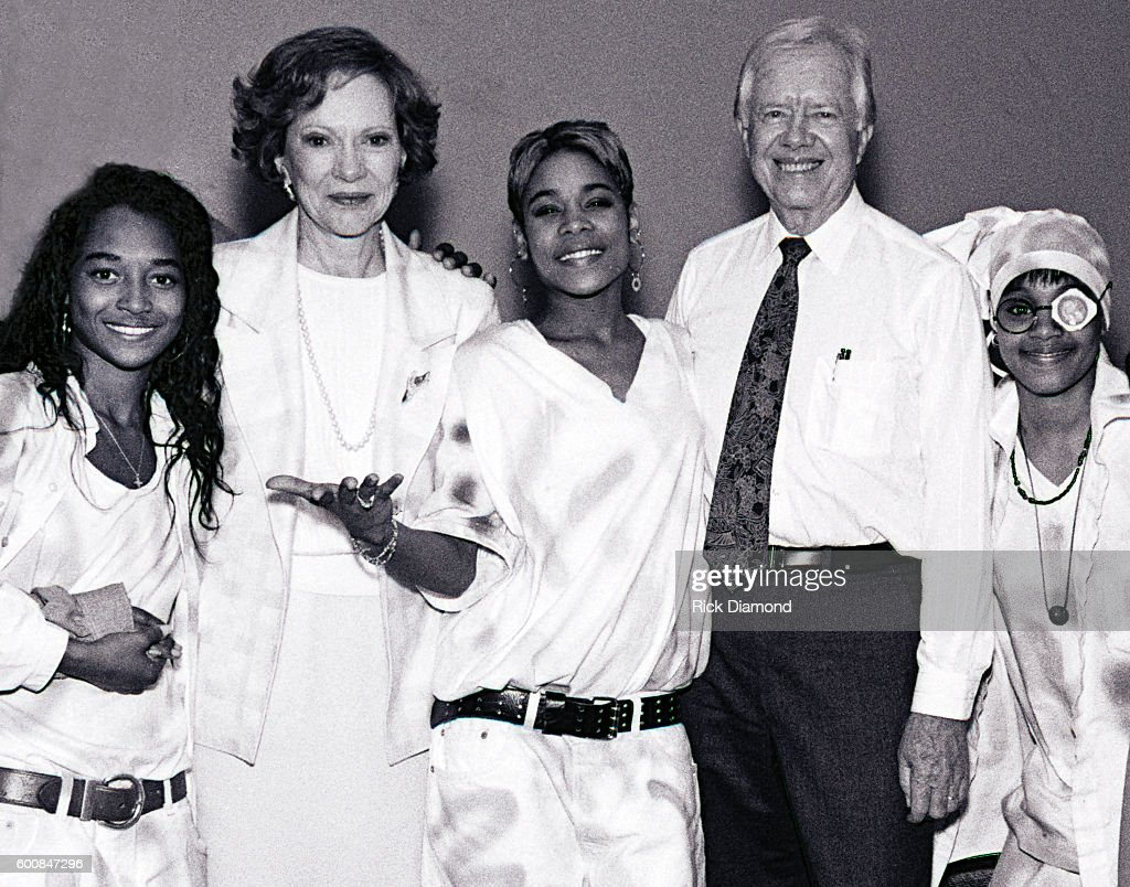 Former President Jimmy Carter, co-chairman of the Heal Our Children/Heal The World initiative with Singer/Songwriter TLC, Rozonda 'Chilli' Thomas, Rosalynn Carter, Tionne 'T-Boz' Watkins, Jimmy Carter and Lisa 'Left Eye' Lopes backstage at The Omni Coliseum in Atlanta Georgia. May 5, 1993