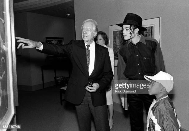 Former President Jimmy Carter gives Michael Jackson and Emmanuel Lewis a tour of his office at The Carter Center both Jackson and Lewis are in...