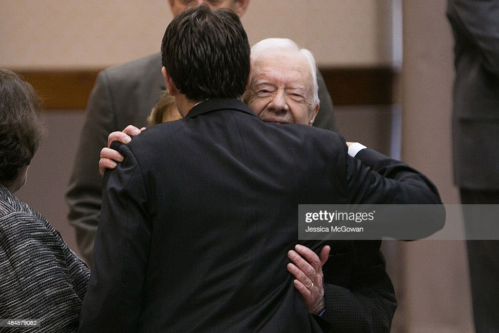 Former President Jimmy Carter hugs his grandson, Jason Carter, before discussing his cancer diagnosis during a press conference at the Carter Center on August 20, 2015 in Atlanta, Georgia. Carter confirmed that he has melanoma that has spread to his liver and brain and will start treatment today.
