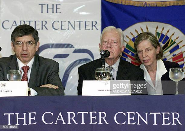 US former President Jimmy Carter speaks to the press nexto to the head of the Organization of American States Cesar Gaviria after their meeting with...