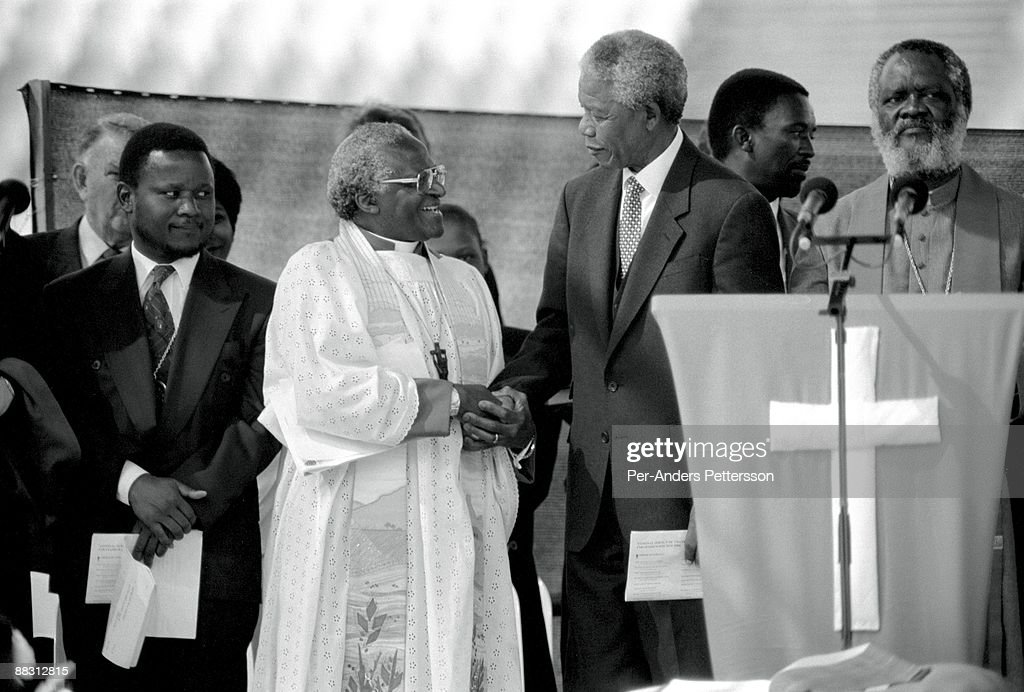 Former President <a gi-track='captionPersonalityLinkClicked' href=/galleries/search?phrase=Nelson+Mandela&family=editorial&specificpeople=118613 ng-click='$event.stopPropagation()'>Nelson Mandela</a> of South Africa greets <a gi-track='captionPersonalityLinkClicked' href=/galleries/search?phrase=Desmond+Tutu&family=editorial&specificpeople=214730 ng-click='$event.stopPropagation()'>Desmond Tutu</a> at a pre-election rally weeks before the historic democratic election on April 15, 1994 in Soweto, South Africa. The ANC freedom fighter was in prison for 27 years and released in 1990. He became President of South Africa after the first multiracial democratic elections in April 1994. Mr. Mandela retired after one term in 1999 and gave the leadership.