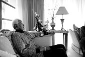 Former President Nelson Mandela of South Africa relaxes while on holiday on June 14 2006 in Maputo Mozambique He is retired and takes time off with...