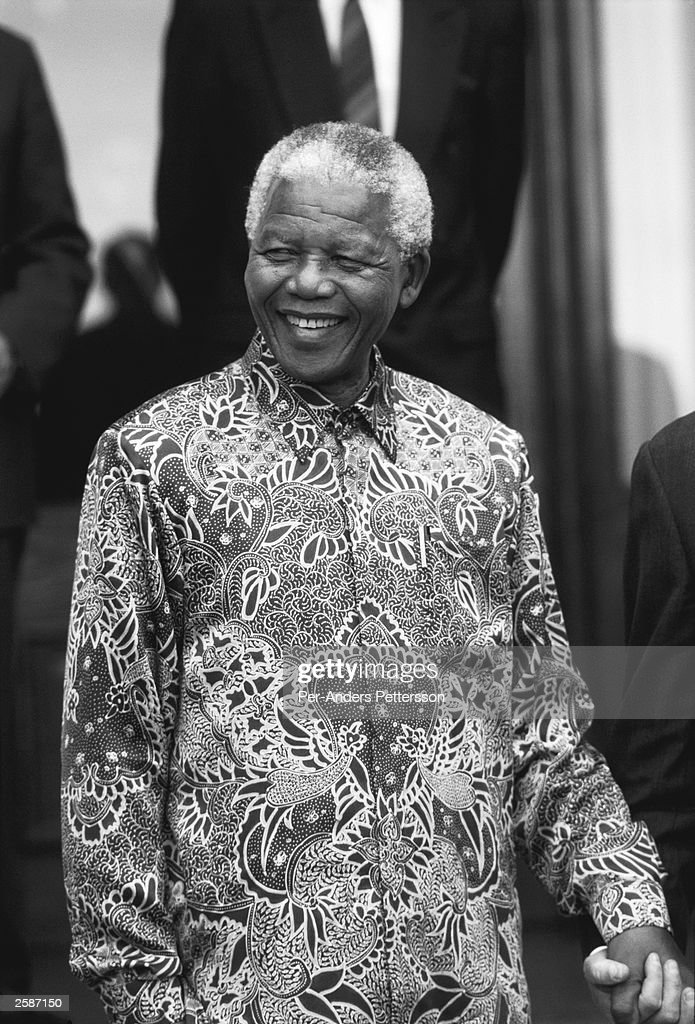 Former President <a gi-track='captionPersonalityLinkClicked' href=/galleries/search?phrase=Nelson+Mandela&family=editorial&specificpeople=118613 ng-click='$event.stopPropagation()'>Nelson Mandela</a> of South Africa smiles as he greats people outside his home September, 25 1998 in Pretoria, South Africa. The ANC freedom fighter was in prison for 27 years and released in 1990. He became President of South Africa after the first multiracial democratic elections in April 1994. Mr Mandela retired after one term in 1999 and gave the leadership to the current president Mr Thabo Mbeki.