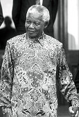 Former President Nelson Mandela of South Africa smiles as he greets people outside his home September 25 1998 in Pretoria South Africa The ANC...