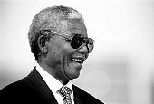 Former President Nelson Mandela of South Africa smiles as he greets people at a preelection rally weeks before the historic democratic election on...