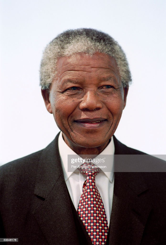Former President <a gi-track='captionPersonalityLinkClicked' href=/galleries/search?phrase=Nelson+Mandela&family=editorial&specificpeople=118613 ng-click='$event.stopPropagation()'>Nelson Mandela</a> of South Africa smiles as he greets people at a pre-election rally weeks before the historic democratic election on April 15, 1994 in Soweto, South Africa. The ANC freedom fighter was in prison for 27 years and released in 1990. He became President of South Africa after the first multiracial democratic elections in April 1994. Mr. Mandela retired after one term in 1999 and gave leadership to the current president Mr. Thabo Mbeki.