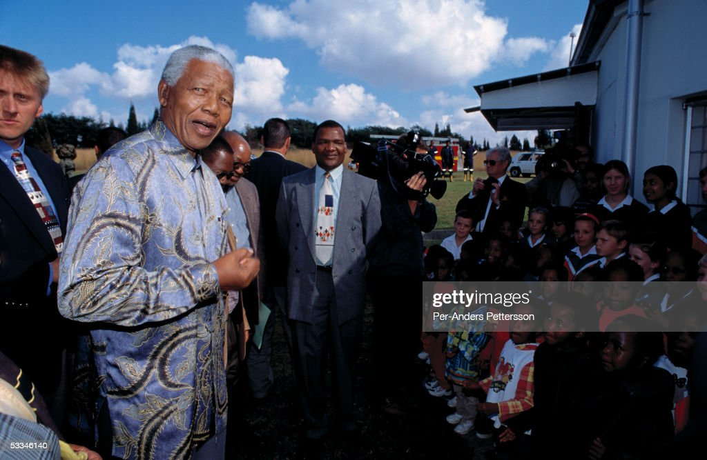 Former President <a gi-track='captionPersonalityLinkClicked' href=/galleries/search?phrase=Nelson+Mandela&family=editorial&specificpeople=118613 ng-click='$event.stopPropagation()'>Nelson Mandela</a> of South Africa speaks to school children during a election stop on May 1, 1999 in Eastcourt, South Africa. The ANC freedom fighter was in prison for 27 years and released in 1990. He became President of South Africa after the first multiracial democratic elections in April 1994. Mr. Mandela retired after one term in 1999 and gave the leadership to the current president Mr. Thabo Mbeki.