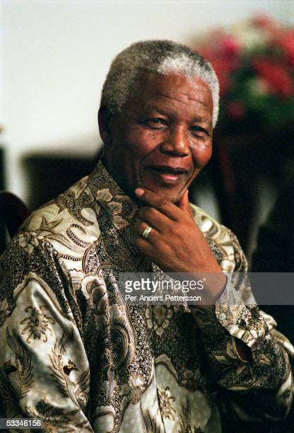 Former President Nelson Mandela of South Africa speaks to visitors on March 8 1999 in his residence in Houghton a suburb of Johannesburg South Africa...