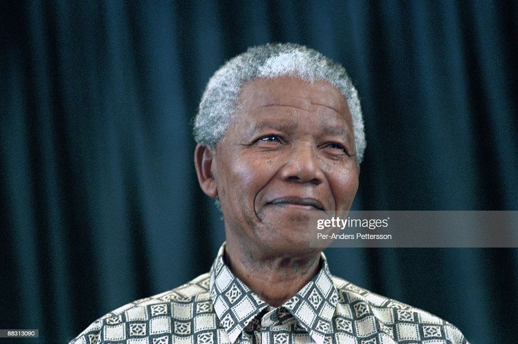 Former President <a gi-track='captionPersonalityLinkClicked' href=/galleries/search?phrase=Nelson+Mandela&family=editorial&specificpeople=118613 ng-click='$event.stopPropagation()'>Nelson Mandela</a> of South Africa speaks to visitors on March 8, 1999 in his residence in Houghton, a suburb of Johannesburg, South Africa. The ANC freedom fighter was in prison for 27 years and released in 1990. He became President of South Africa after the first multiracial democratic elections in April 1994. Mr. Mandela retired after one term in 1999 and gave leadership to the current president Mr. Thabo Mbeki.