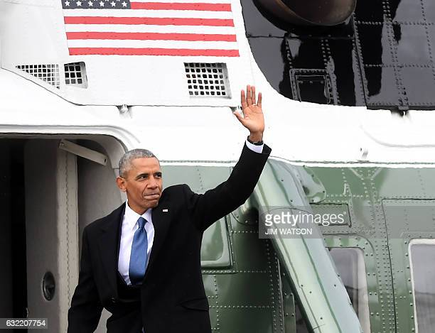 TOPSHOT Former President Obama waves from the helicopter he departs the US Capitol after inauguration ceremonies in Washington DC on January 20 2017...