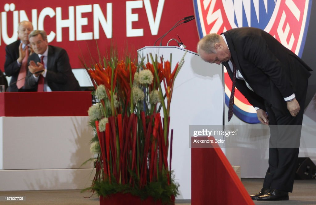 Former president of Bayern Muenchen <a gi-track='captionPersonalityLinkClicked' href=/galleries/search?phrase=Uli+Hoeness&family=editorial&specificpeople=634868 ng-click='$event.stopPropagation()'>Uli Hoeness</a> (R) takes a bow after his speech as CFO <a gi-track='captionPersonalityLinkClicked' href=/galleries/search?phrase=Karl+Hopfner&family=editorial&specificpeople=635248 ng-click='$event.stopPropagation()'>Karl Hopfner</a> (C) and vice president Rudolf Schels applaud to him at the extraordinary members meeting of FC Bayern Muenchen at Audi-Dome on May 2, 2014 in Munich, Germany.
