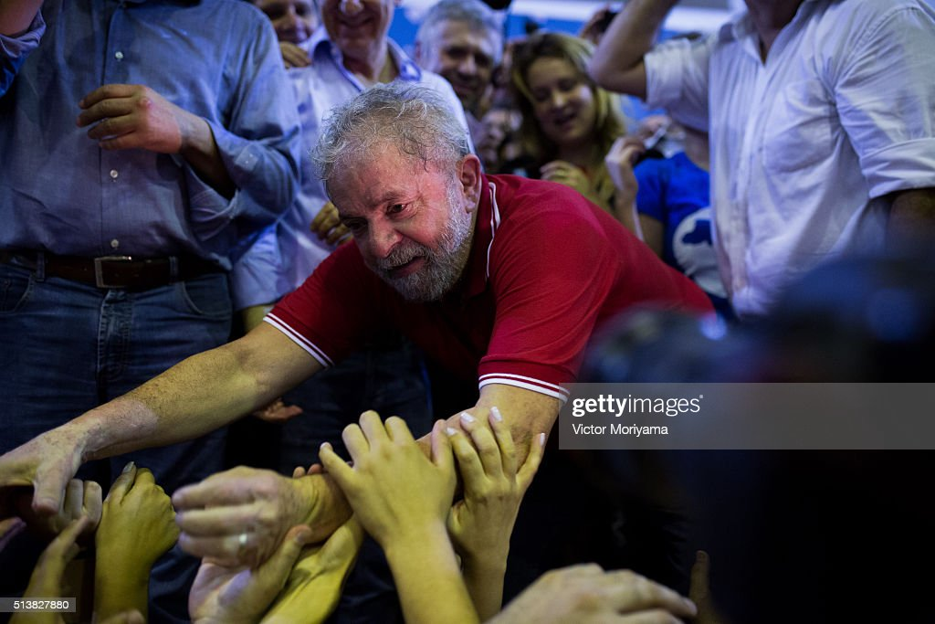 Former President of Brazil, Luiz Inacio Lula da Silva greets supporters at a rally at the Partido dos Trabalhadores headquarters on March 4, 2016, in Sao Paulo, Brazil. Lula is accused of corruption and embezzlement in the Federal Police investigation involving fraud at Petrobras company.