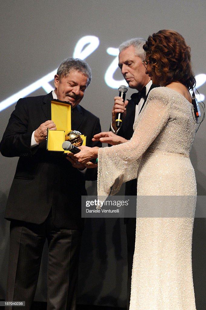 Former President of Brazil, <a gi-track='captionPersonalityLinkClicked' href=/galleries/search?phrase=Luiz+Inacio+Lula+da+Silva&family=editorial&specificpeople=211609 ng-click='$event.stopPropagation()'>Luiz Inacio Lula da Silva</a>, Pirelli & C President Marco Tronchetti Provera and <a gi-track='captionPersonalityLinkClicked' href=/galleries/search?phrase=Sophia+Loren&family=editorial&specificpeople=94097 ng-click='$event.stopPropagation()'>Sophia Loren</a> attend the '2013 Pirelli Calendar Unveiling' on November 27, 2012 in Rio de Janeiro, Brazil.