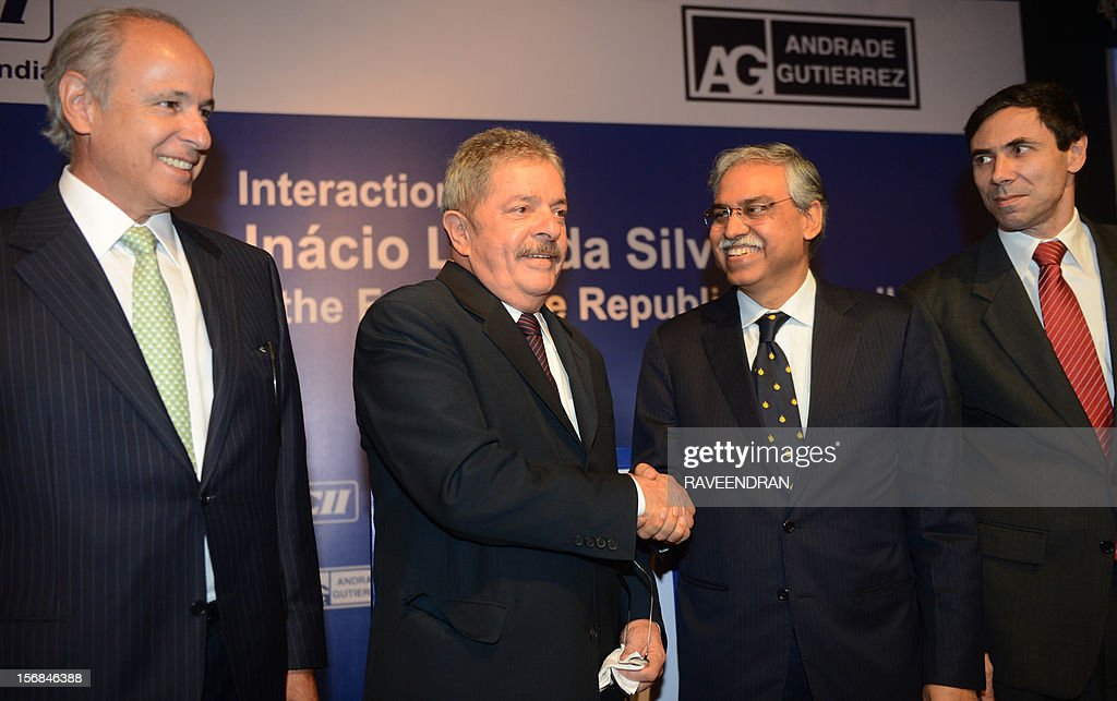 Former President of Brazil, Luiz Inacio Lula da Silva (2L) shakes hands with Chairman, Hero Motors Corporate Services, Sunil Kant Munjal (2R) as CEO, Andrade Gutierrez (AG) group Otavio Azevedo (L) and Ambassador of Brazil to India, Carios Duarte (R) look on during a interaction meeting in New Delhi on November 23, 2012. Lula is in India for a two-day visit.