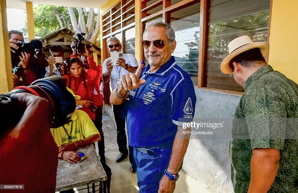 Former President of East Timor Jose Ramos Horta shows his tinted finger after vote during parliamentary election in Dili on July 22, 2017. East Timor headed to the polls to elect a new parliament as Asia's youngest democracy battles economic challenges 15 years after gaining its independence from Indonesia.