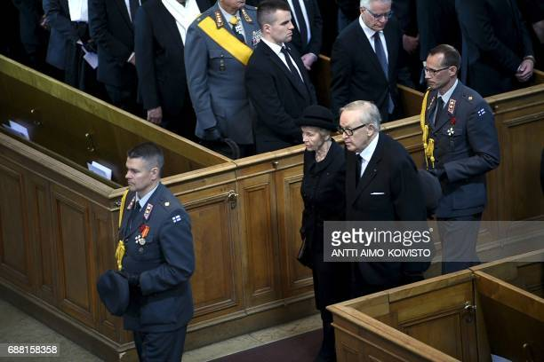 Former president of Finland Martti Ahtisaari and spouse Eeva Ahtisaari leave after the state funeral ceremony of Finland's former President Mauno...