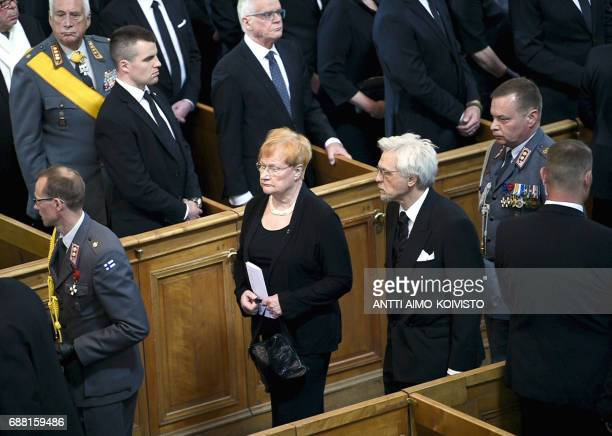 Former president of Finland Tarja Halonen and spouse Pentti Arajaervi leave after the state funeral ceremony of Finland's former President Mauno...