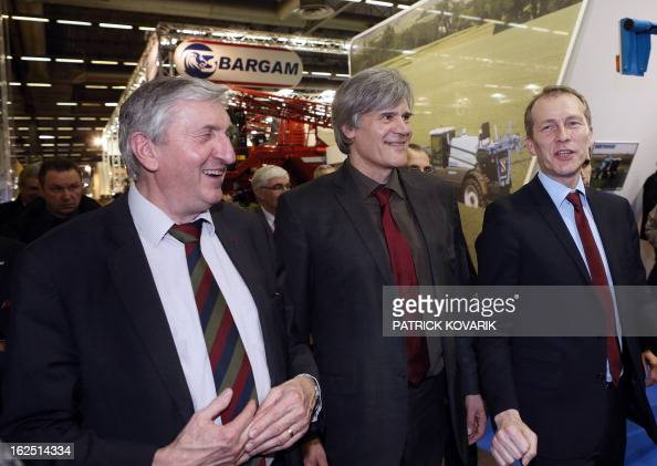 Former president of France's National Federation of Agricultural Holders' Unions JeanMichel Lemetayer speaks with France's Agriculture Minister...