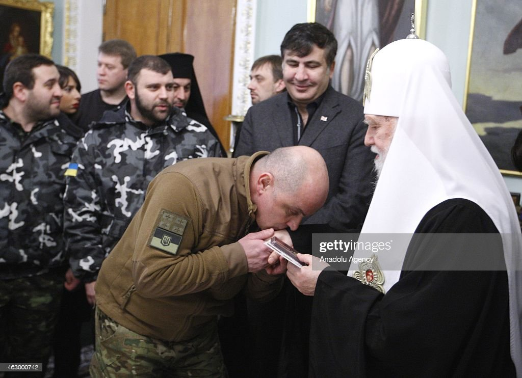 Former president of Georgia Mikheil Saakashvili (2nd R) and Patriarch Filaret (R) attend a ceremony held for the 29 volunteer Georgian people fighting against the pro-Russian separatists, in Kiev, Ukraine on February 08, 2015. Volunteers are granted with an award for their sacrifices for Ukraine's peace during the ceremony.