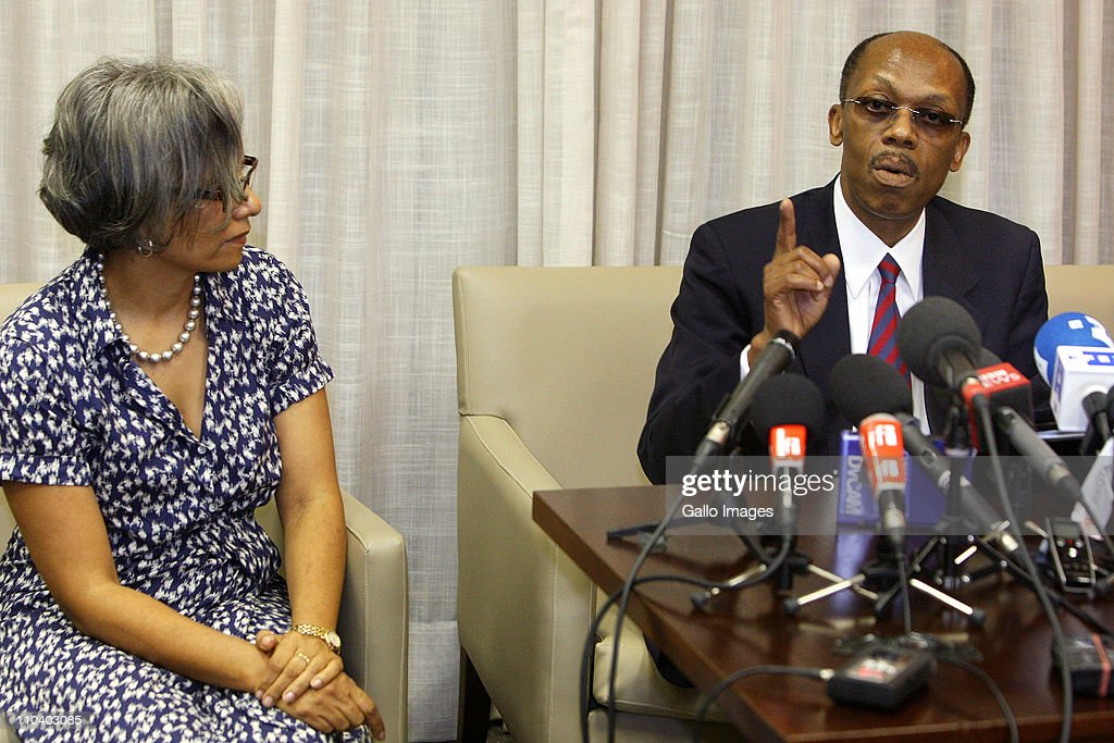 Former President of Haiti JeanBertrand Aristide reads a statement which he prepared in Zulu at Lanseria airport on March 17 2011 in Johannesburg...