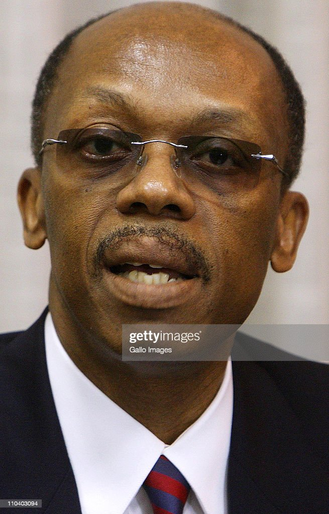Former President of Haiti Jean-Bertrand Aristide reads a statement, which he prepared in Zulu, at Lanseria airport on March 17, 2011 in Johannesburg, South Africa. After seven years in exile Aristide was preparing to leave South Africa and make his way back to Haiti.