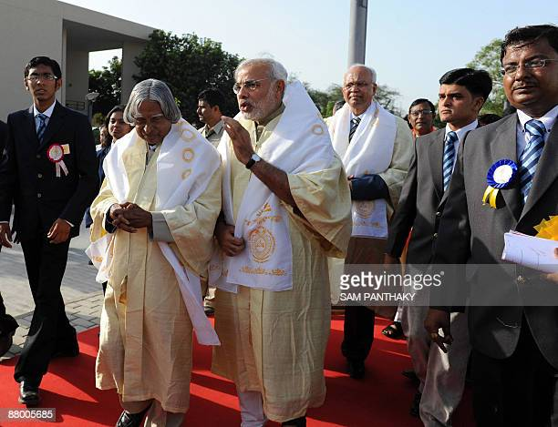 Former President of India APJ Abdul Kalam and Gujarat state Chief Minister Narendra Modi discuss while on the way to the venue of the first...