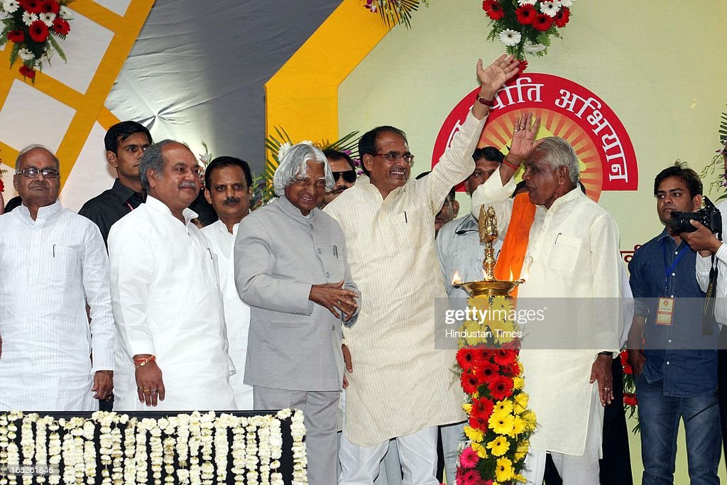Former president of India Dr. APJ Abdul Kalam along with chief minister Shivraj Singh Chouhan, State BJP president Narendra Singh Tomar, minister Jayant Malaiya, Babulal Gaur and Rajendra Shukla after the inauguration of 'Atal Jyoti Abhiyan' that marks the beginning of 24/7 power supply in Bhopal District on April 2, 2013 in Bhopal, India.