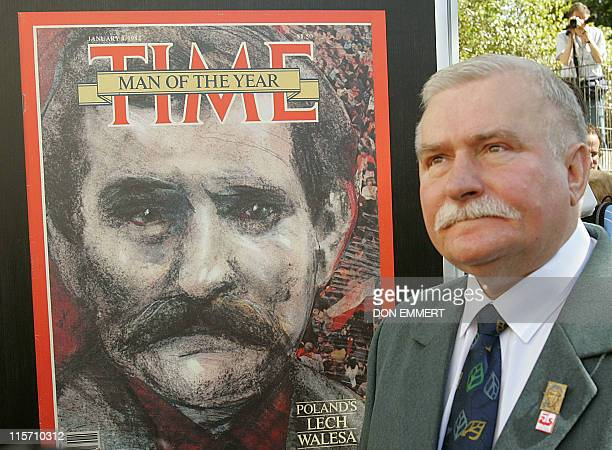 Former President of Poland Lech Walesa stands next to a Time Magazine cover featuring a likeness of himself at an exhibit called 'Poland on the Front...
