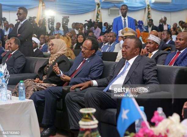 Former President of Somalia Hassan Sheikh Mohamud and President of Kenya Uhuru Kenyatta attend Somalia's new President Mohamed Abdullahi Mohamed's...