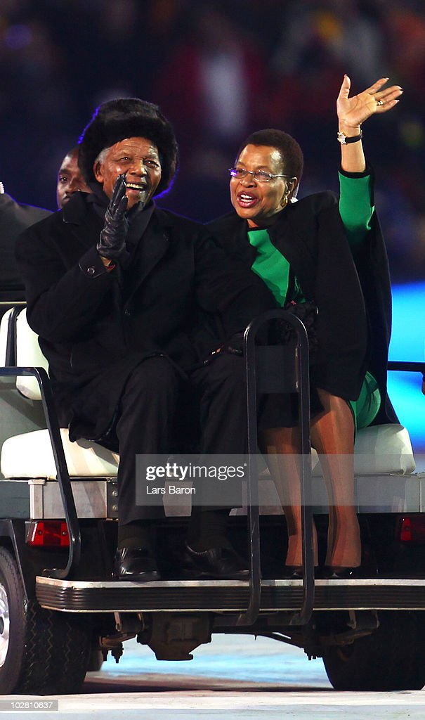 Former President of South Africa <a gi-track='captionPersonalityLinkClicked' href=/galleries/search?phrase=Nelson+Mandela&family=editorial&specificpeople=118613 ng-click='$event.stopPropagation()'>Nelson Mandela</a> and his wife Graca Machel smile and wave to the crowd ahead of the 2010 FIFA World Cup South Africa Final match between Netherlands and Spain at Soccer City Stadium on July 11, 2010 in Johannesburg, South Africa.