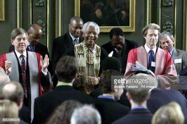 Former President of South Africa Nelson Mandela dances to the Magdalene College choir Cambridge after a ceremony where he was made an Honorary Fellow...